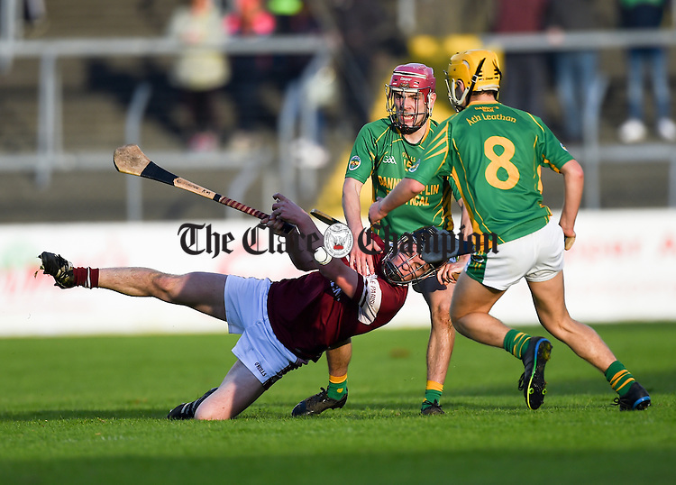 Diarmuid O Brien and  Diarmuid O Brien of Broadford in action against Kevin Meaney of St Joseph's Doora Barefield during their Intermediate county final in Cusack Park. Photograph by John Kelly.