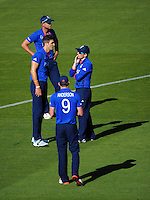 Eoin Morgan discusses bowling strategy with Steven Finn during the ICC Cricket World Cup one day pool match between the New Zealand Black Caps and England at Wellington Regional Stadium, Wellington, New Zealand on Friday, 20 February 2015. Photo: Dave Lintott / lintottphoto.co.nz