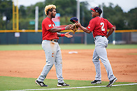 Brevard County Manatees left fielder David Denson (13) gets his hat and glove from center fielder Corey Ray (2) in between innings during a game against the Lakeland Flying Tigers on August 8, 2016 at Henley Field in Lakeland, Florida.  Lakeland defeated Brevard County 6-2.  (Mike Janes/Four Seam Images)