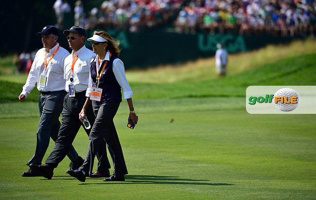 USGA President Diana Murphy,right, walks down fairway with Mike Davis,middle, during fourth round 116th US Open 2016 ,Oakmont Country Club, Pittsburgh,Pennsylvania,USA.