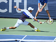 Washington, DC - August 9, 2015: Kei Nishikori of Japan leaps to make a backhand shot during the ATP Citi Open men's final at Rock Creek Park Tennis Center in Washington, DC  August 9, 2015.  (Photo by Elliott Brown/Media Images International)