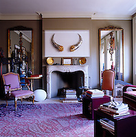 "The apartment is crammed with works of art including Ann Carrington's ""Horns"" above the fireplace, a sculpture constructed entirely from bone-handled knives"