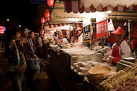 Stall selling meat kebabs and soup dumplings in the Night Market, Wangfujing Street, Beijing, China