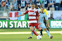 Daniel Hernandez (2) FC Dallas midfielder watched by Graham Zusi Sporting KC... Sporting Kansas City defeated FC Dallas 2-1 at LIVESTRONG Sporting Park, Kansas City, Kansas.