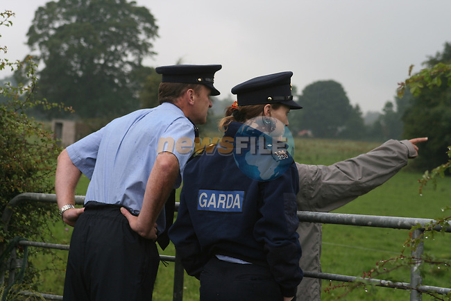 Police question and move off protestors outside the Lismullin site before the Press Briefing about the M3 Motorway...Photo NEWSFILE/Jenny Matthews.(Photo credit should read Jenny Matthews/NEWSFILE)....This Picture has been sent you under the condtions enclosed by:.Newsfile Ltd..The Studio,.Millmount Abbey,.Drogheda,.Co Meath..Ireland..Tel: +353(0)41-9871240.Fax: +353(0)41-9871260.GSM: +353(0)86-2500958.email: pictures@newsfile.ie.www.newsfile.ie.FTP: 193.120.102.198.