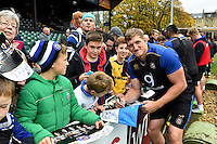Stuart Hooper of Bath Rugby mingles and signs autographs with supporters at the end of the session. Bath Rugby Captain's Run on October 30, 2015 at the Recreation Ground in Bath, England. Photo by: Patrick Khachfe / Onside Images
