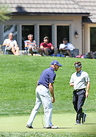 04 AUG 13  The Bradley Gang looks on as Josh Teater and Trevor Immelman finish putting on the 12th green during Sunday's Final Round action at The Reno Tahoe Open at The Montreux Country Club in Reno, Nevada.  (photo:  kenneth e.dennis / kendennisphoto.com)