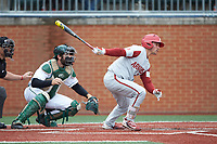 Dominic Fletcher (24) of the Arkansas Razorbacks follows through on his swing against the Charlotte 49ers at Hayes Stadium on March 21, 2018 in Charlotte, North Carolina.  The 49ers defeated the Razorbacks 6-3.  (Brian Westerholt/Four Seam Images)