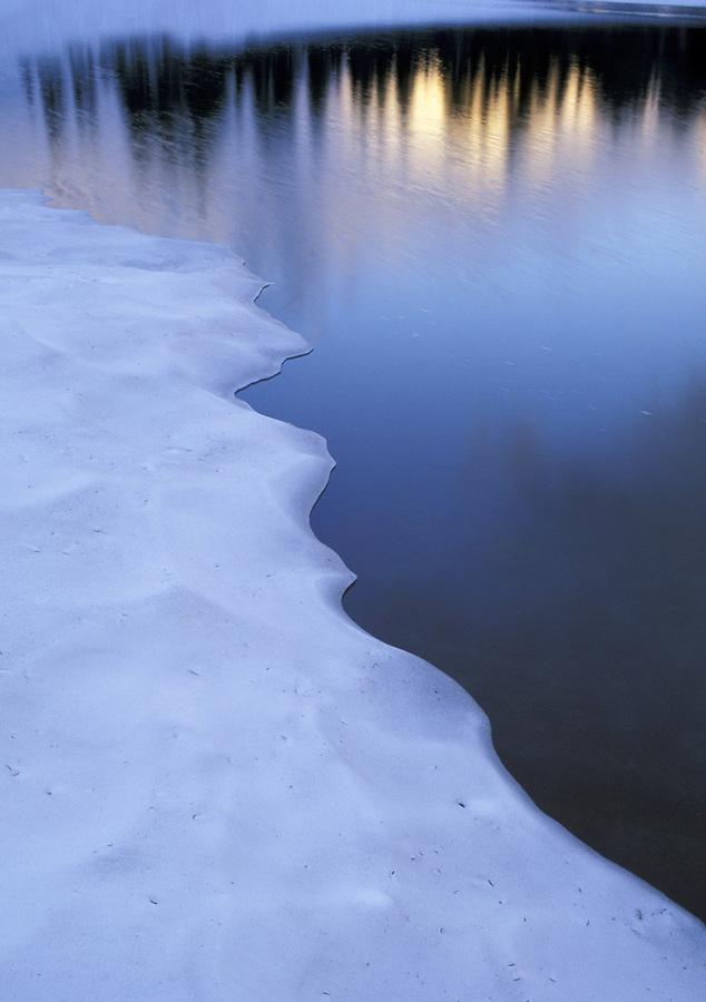 Snow on lake shoreline, Washington