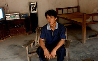 Single man, Cai Fu San, 27, who lives alone on the edge of Danzhou city, Hainan Island. Cai is the third child of a four-son family and all except for the second remain single. Danzhou city has the highest gender imbalance in China with 170 males born for every 100 females according to figures from Chinese Government 5t National Census. The imbalance is already having a massive social impact on society and is expected to get worse while the ruthless One Child Policy, aimed at curbing China's 1.3 billion population, continues to be law. The area is begining to rigidly enforce the policy due to the massive problem of gender selection..PHOTO BY SINOPIX