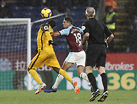 Brighton & Hove Albion's Yves Bissouma vies for possession with Burnley's Ashley Westwood watched closely by Referee Martin Atkinson<br /> <br /> Photographer Rich Linley/CameraSport<br /> <br /> The Premier League - Burnley v Brighton and Hove Albion - Saturday 8th December 2018 - Turf Moor - Burnley<br /> <br /> World Copyright © 2018 CameraSport. All rights reserved. 43 Linden Ave. Countesthorpe. Leicester. England. LE8 5PG - Tel: +44 (0) 116 277 4147 - admin@camerasport.com - www.camerasport.com