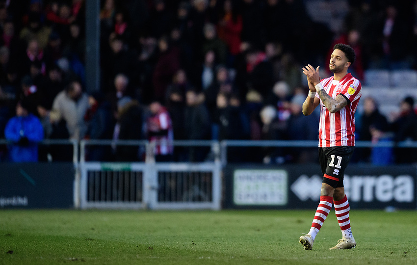 Lincoln City's Bruno Andrade applauds the fans at the final whistle<br /> <br /> Photographer Chris Vaughan/CameraSport<br /> <br /> The EFL Sky Bet League Two - Lincoln City v Northampton Town - Saturday 9th February 2019 - Sincil Bank - Lincoln<br /> <br /> World Copyright © 2019 CameraSport. All rights reserved. 43 Linden Ave. Countesthorpe. Leicester. England. LE8 5PG - Tel: +44 (0) 116 277 4147 - admin@camerasport.com - www.camerasport.com