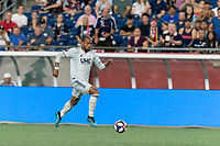 FOXBOROUGH, MA - AUGUST 4: Teal Bunbury #10 of New England Revolution dribbles down the wing during a game between Los Angeles FC and New England Revolution at Gillette Stadium on August 3, 2019 in Foxborough, Massachusetts.