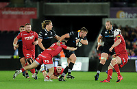 Ospreys' Scott Otten is tackled by Scarlets' Steffan Evans<br /> <br /> Photographer Ashley Crowden/CameraSport<br /> <br /> Guinness Pro14 Round 6 - Ospreys v Scarlets - Saturday 7th October 2017 - Liberty Stadium - Swansea<br /> <br /> World Copyright &copy; 2017 CameraSport. All rights reserved. 43 Linden Ave. Countesthorpe. Leicester. England. LE8 5PG - Tel: +44 (0) 116 277 4147 - admin@camerasport.com - www.camerasport.com