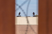 MEXICALI, MEXICO - April 5 Security personnel of the United States are seen thru US-Mexico Border fence from the Mexican side on April 5, 2019 in Mexicali, Mexico.<br /> President Trump on Friday visited Calexico, a small city in a largely agricultural region between Arizona and the Pacific, to inspect an upgraded portion of fencing and to meet with law enforcement. That's more attention than usual for a border town that locals say is defined by its interconnection with Mexico, its infernal summers and its labor-based economy. <br /> (Photo by Luis Boza/VIEWpress)