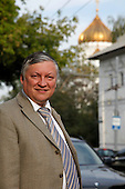Russian chess master Anatoly Karpov poses for a portrait at his office in Moscow, Russia