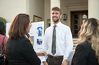 Occidental College student Daniel Stigall '16 shares his InternLA experience working at the Office of Los Angeles Mayor Eric Garcetti during the Career Development Center's Reverse Career Fair, Thorne Hall patio, Sept. 3, 2015.<br /> (Photo by Marc Campos, Occidental College Photographer)