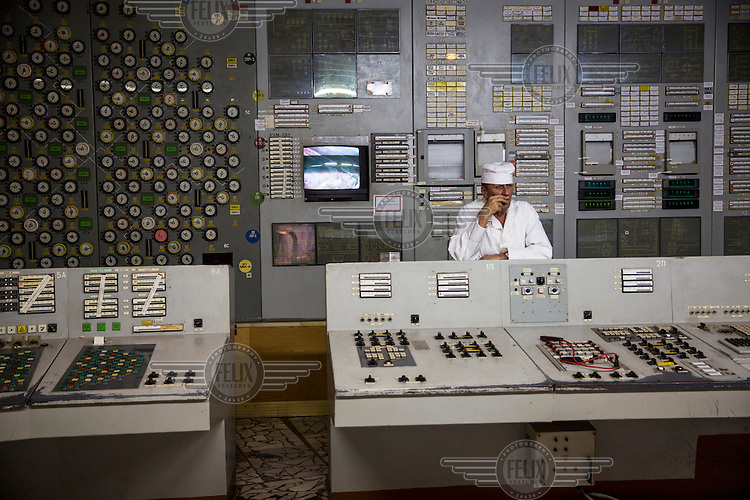 Workers in the Chernobyl power plant control room. The building is still used as offices for the workers cleaning the power plant where Reactor 4 exploded in 1986, causing major leakage of radioactivity.