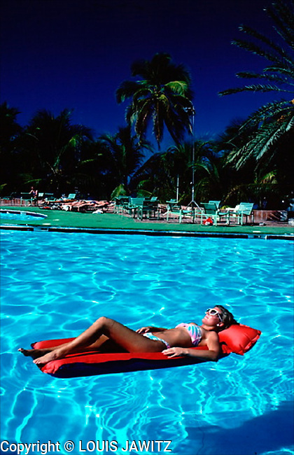 Haiti,lady on raft  Leisure Activity Republic of Haiti Caribbean