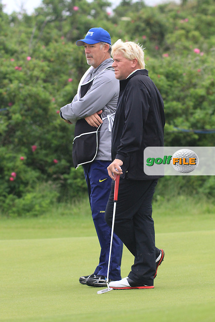 John Daly (USA) and Caddy Pete on the 1st during round 4 of the Irish Open at Royal Portrush GC,Portrush,County Antrim,Ireland. 1/7/12.Picture Fran Caffrey www.golffile.ie