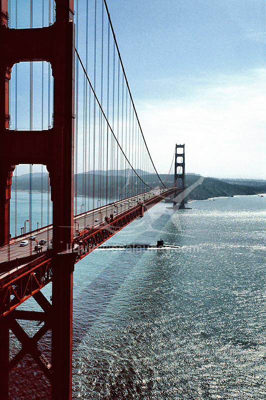 Nuclear submarine passing under the Golden Gate Bridge on his way to the Pacific Ocean, San Francisco, California, United States of America.