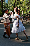 A couple dressed in traditional clothes and dancing during the Hispanic Parade in New York City, representing Argentina