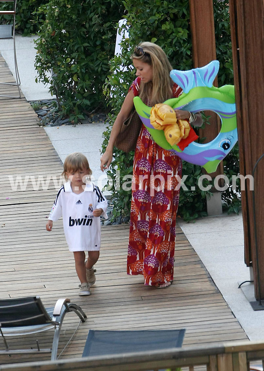 **ALL ROUND PICTURES FROM SOLARPIX.COM**.**WORLDWIDE SYNDICATION RIGHTS**.Sylvie Van der Vaart, wife of Real Madrid footballer Rafael Van der Vaart, relaxing by the swimming pool with their son Damian, before going to watch the match in which Real Madrid beat Valencia 4-2 in the Spanish Supercup. 24th August 2008..This pic:..JOB REF: 7122 EBR        DATE: 24_08_2008.**MUST CREDIT SOLARPIX.COM OR DOUBLE FEE WILL BE CHARGED* *UNDER NO CIRCUMSTANCES IS THIS IMAGE TO BE REPRODUCED FOR ANY ONLINE EDITION WITHOUT PRIOR PERMISSION*