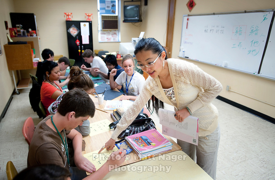 """Yue Zheng (cq, right), explains a test to students during a Chinese 1 class at Macarthur High School in Lawton, Oklahoma, April 29, 2010. Zheng is teaching in the US as part of a """"guest teacher"""" program for two years and will soon be returning to her home in Henan province in China...PHOTO/ MATT NAGER"""