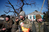UKRAINE, 02.2016, Oblast Donetsk. Ukrainian-Russian conflict concerning Eastern Ukraine: Soldiers of the Ukrainian armed forces fighting the Russian-backed separatists on a transport through a destroyed village near the frontline of Donetsk. © Timo Vogt/EST&OST