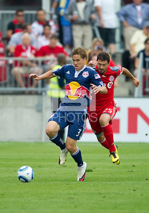 21 August 2010: New York Red Bulls defender Chris Albright #3 and  during a game between the New York Red Bulls and Toronto FC at BMO Field in Toronto..The New York Red Bulls won 4-1.21 August 2010: New York Red Bulls defender Chris Albright #3 and Toronto FC midfielder Martin Saric #25 in action during a game between the New York Red Bulls and Toronto FC at BMO Field in Toronto..The New York Red Bulls won 4-1.