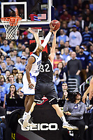 Washington, DC - MAR 11, 2018: Rhode Island Rams guard E.C. Matthews (0) with a big block against Davidson Wildcats guard Rusty Reigel (32) during the Atlantic 10 men's basketball championship between Davidson and Rhode Island at the Capital One Arena in Washington, DC. (Photo by Phil Peters/Media Images International)