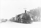 The northbound Chili Line Mixed stops at the Espanola depot for the last time.  A nice 3/4 frontal view of an extra-long train for this line.<br /> D&amp;RGW  Espanola, NM  9/1/1941