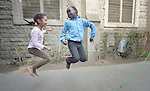 Refugee girls skip rope during a physical education class in a school operated by St. Andrew's Refugee Services in Cairo, Egypt. Located at St. Andrews United Church of Cairo, the program is supported by Church World Service.