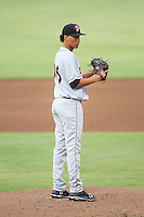 Delmarva Shorebirds starting pitcher Luis Gonzalez (36) looks to his catcher for the sign against the Kannapolis Intimidators at CMC-NorthEast Stadium on July 3, 2014 in Kannapolis, North Carolina.  The Shorebirds defeated the Intimidators 6-5. (Brian Westerholt/Four Seam Images)