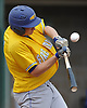 Thomas Paulich #4 of Kellenberg lifts a sacrifice fly to right field to plate a run in the top of the second inning of the CHSAA varsity baseball semifinals against St. Dominic at Farmingdale State College on Tuesday, May 24, 2016. Kellenberg won by a score 5-3.