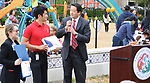 State Representative Gene Wu gifts the school with a state flag that has flown over the Texas Capitol at the Dragon and Phoenix Spark Park dedication ceremony at Mandarin Immersion Magnet School on Oct. 27, 2017.