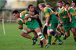 Drury No8 K. Vea tries to break the tackle of S. Kotoa.  Counties Manukau Premier Club Rugby, Drury vs Bombay played at the Drury Domain, on the 14th of April 2006. Bombay won 34 - 13.