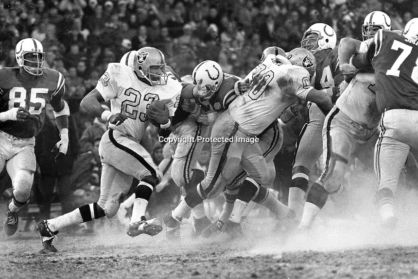 Oakland Raiders vs Baltimore Colts 1971 Playoff game in Baltimore. Raider Charlie Smith running behind center Jim Otto and the rest of the line. (photo 1971<br />
