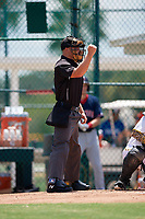 Umpire Matt Blackborow calls a strike during a Gulf Coast League game between the GCL Red Sox and GCL Pirates on August 1, 2019 at Pirate City in Bradenton, Florida.  GCL Red Sox defeated the GCL Pirates 11-3.  (Mike Janes/Four Seam Images)