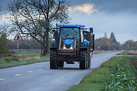 New Holland tractor and trailer on a public road<br /> &copy;Tim Scrivener Photographer 07850 303986<br />      ....Covering Agriculture In The UK....