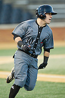 Ryan Quinn (30) of the Cincinnati Bearcats hustles down the first base line against the Wake Forest Demon Deacons at Wake Forest Baseball Park on February 21, 2014 in Winston-Salem, North Carolina.  The Bearcats defeated the Demon Deacons 5-0.  (Brian Westerholt/Four Seam Images)