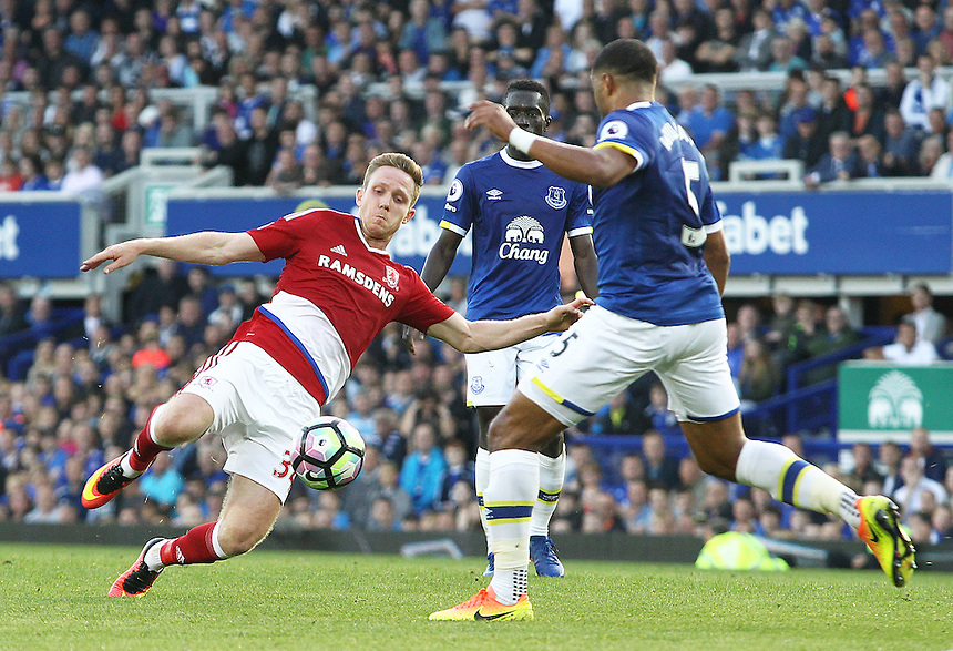 Middlesbrough's Adam Forshaw launches into a tackle on Everton's Ashley Williams<br /> <br /> Photographer Rich Linley/CameraSport<br /> <br /> The Premier League - Everton v Middlesbrough - Saturday 17th September 2016 - Goodison Park - Liverpool<br /> <br /> World Copyright &copy; 2016 CameraSport. All rights reserved. 43 Linden Ave. Countesthorpe. Leicester. England. LE8 5PG - Tel: +44 (0) 116 277 4147 - admin@camerasport.com - www.camerasport.com
