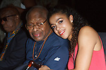 Fine artist, dancer, actress, Cajai Fellows Johnson poses with her father, at the Art of Persuasion event at Beautique on 8 West 58 Street, in New York City on November 19, 2016.