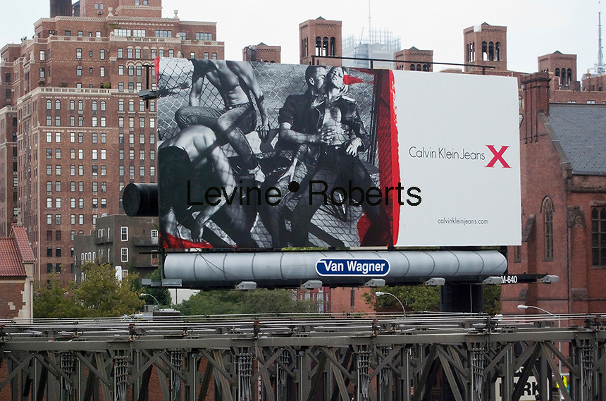 A Calvin Klein billboard in the Chelsea neighborhood of New York on Sunday, August 8, 2010.  Klein's advertisements use sex and provocative images to test society's cultural and moral boundries. (© Richard B. Levine)
