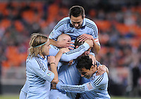 Sporting Kansas City defender Matt Besler (5) celebrates with teammates his score in the 54th minute of the game. Sporting Kansas City defeated D.C. United 1-0 at RFK Stadium,Saturday October 22, 2011.