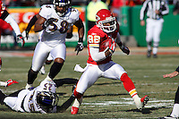Chiefs Dante Hall (82) returns the opening kickoff 35 yards escaping the grasp of Baltimore cornerback Evan Oglesby (25) at Arrowhead Stadium in Kansas City, Missouri on December 10, 2006.