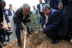 "Palestinian prime minister Salam Fayyad participates in a cultivation of olive trees on the occasion of ""Land Day"", in the West Bank city of of Jaffna, on March 30, 2013. Land Day marks the annual event that commemorates the deaths of six Arab Israeli protesters at the hands of Israeli forces during mass demonstrations in 1976 against plans to confiscate Arab land in northern Israel. Photo by Mustafa Abu Dayeh"