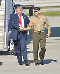 WEST PALM BEACH, FL - FEBRUARY 17: U.S. President Donald J. Trump shake hand with a military soldier as he arrives on Air Force One at the Palm Beach International airport as they prepare to spend part of the weekend at Mar-a-Lago resort on February 17, 2017 in West Palm Beach, Florida. After touring and meeting with Dennis Muilenburg Chairman of the Board, President, and CEO of the Boeing Company in North Charleston, South Carolina.  President Trump schedule to hold a campaign rally tomorrow at Melbourne Florida. ( Photo by Johnny Louis / jlnphotography.com )