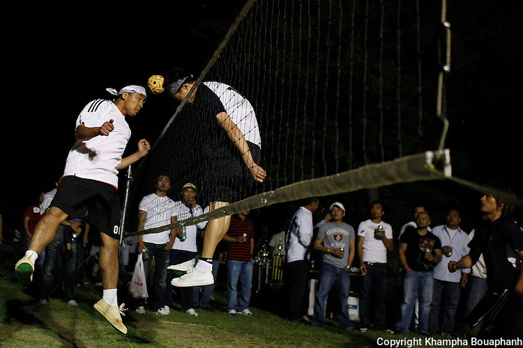 Tee Rathida of Charlotte, North Carolina, left, heads the ball against Poxay Phetsavong of Haltom City, Texas during a kator tournament during the Lao New Year celebration at Wat Lao Thepnimith in Fort Worth on April 24, 2010.  (photo by Khampha Bouaphanh)