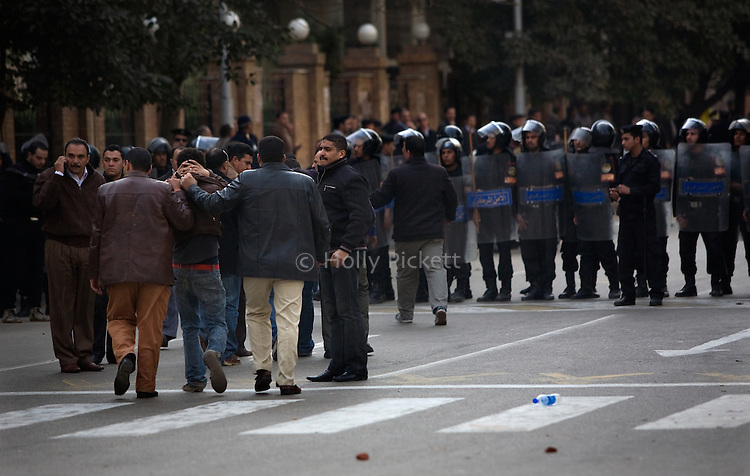 Plain-clothes police arrest a man near the Journalists' Syndicate in downtown Cairo, Egypt, Jan. 26, 2011. Violent clashes between demonstrators and police continued into a second day, as protesters attempted to build momentum in a movement inspired by the recent Tunisian uprising.